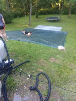 We made a outdoor tarp slide. Soaping up was the ticket down. Funnest thing ever!