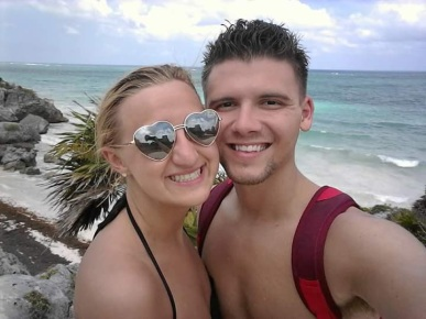 Tulum, Mexico. We just got done swimming in the ocean. It was the clearest, most beautiful beach I had ever seen in my life!